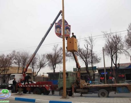 ادامه عملیات نصب تمثال تصاویر شهدای شهر مبارکه و محلات تابعه